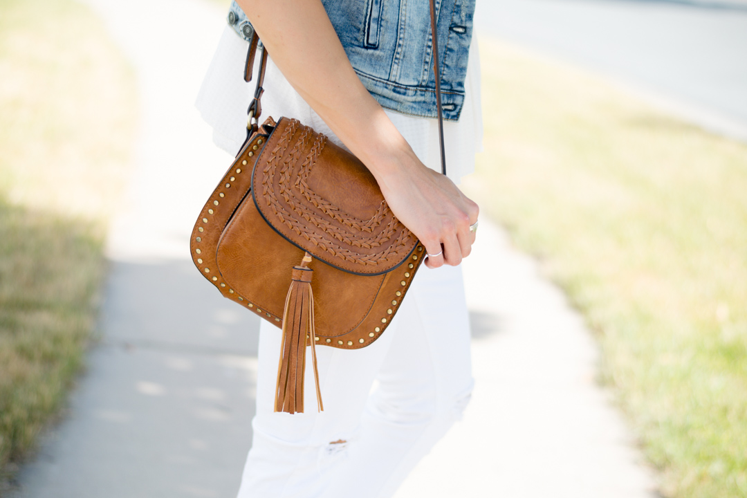 cognac-tassel-saddle-bag