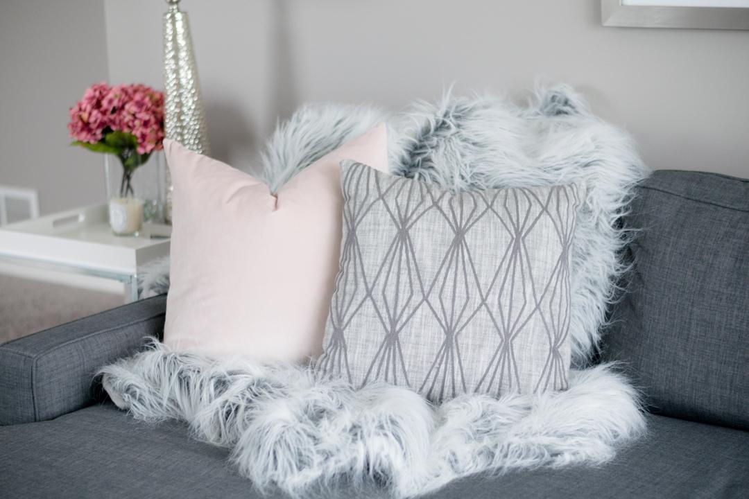 neutral throw pillows, faux fur throw, gray couch