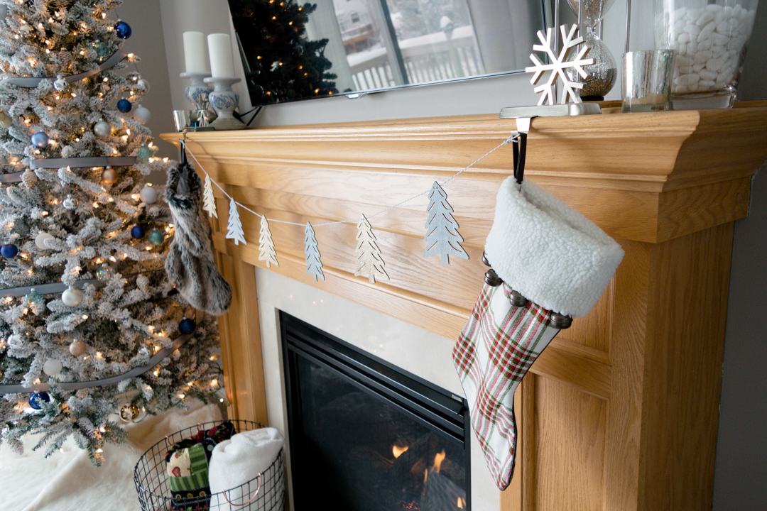 mantle christmas decor, stockings on mantle, garland on fireplace