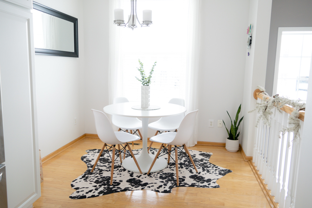 neutral kitchen decor, ikea docksta table, eiffel kitchen chairs, breakfast nook, faux cowhide rug
